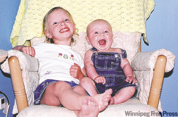 Brandon at six months has a laugh with sister Hayley.