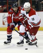 Jiri Tlusty (right) has 13 goals and 23 points in 52 games this season but was a minus-17 with the sad-sack Hurricanes.
