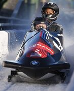 Elana Meyers Taylor and Cherrelle Garrett, of the United States, finish in first place at the women's World Cup bobsled event in Calgary, Saturday, Dec. 20, 2014. THE CANADIAN PRESS/Jeff McIntosh