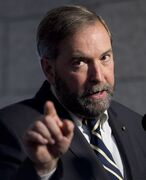 NDP leader Tom Mulcair speaks with the media following caucus on Parliament Hill Wednesday May 1, 2013 in Ottawa. THE CANADIAN PRESS/Adrian Wyld