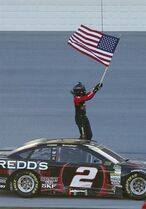 Brad Keselowski celebrates after winning the NASCAR Sprint Cup Series auto race at Talladega Superspeedway, Sunday, Oct. 19, 2014, in Talladega, Ala. (AP Photo/John Bazemore)