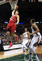 Portland Trail Blazers center Meyers Leonard goes up for a basket against the Milwaukee Bucks during the first half of an NBA basketball game Saturday, Jan. 31, 2015, in Milwaukee. Leonard missed the basket. (AP Photo/Darren Hauck)