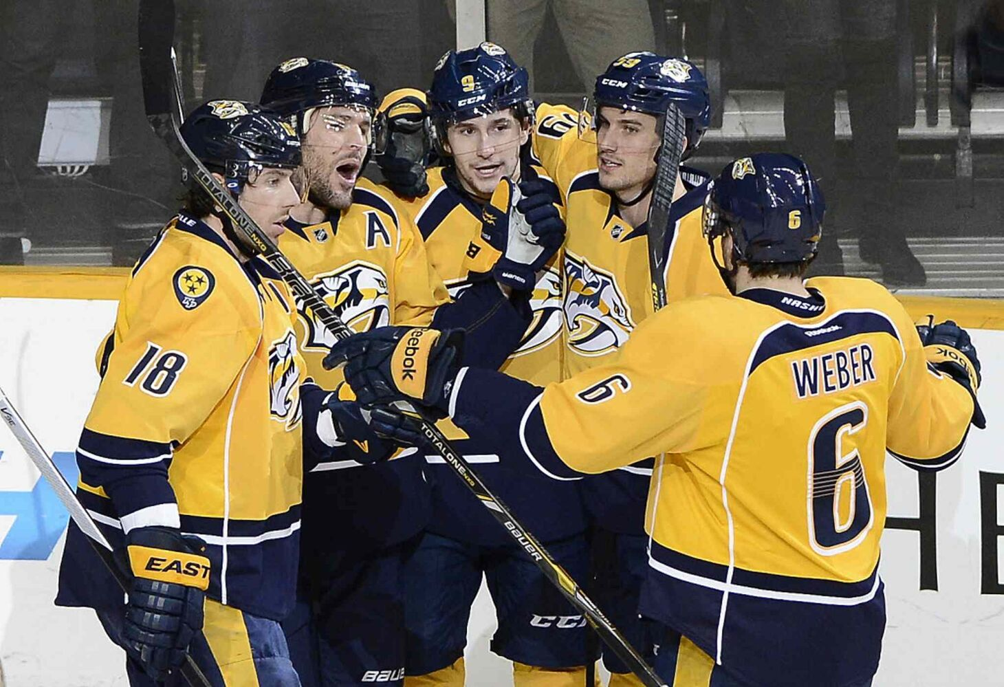 Nashville Predators centre Filip Forsberg, centre, is congratulated after scoring a goal against the Winnipeg Jets in the second period of Thursday's game. (Mark Zaleski / The Associated Press)