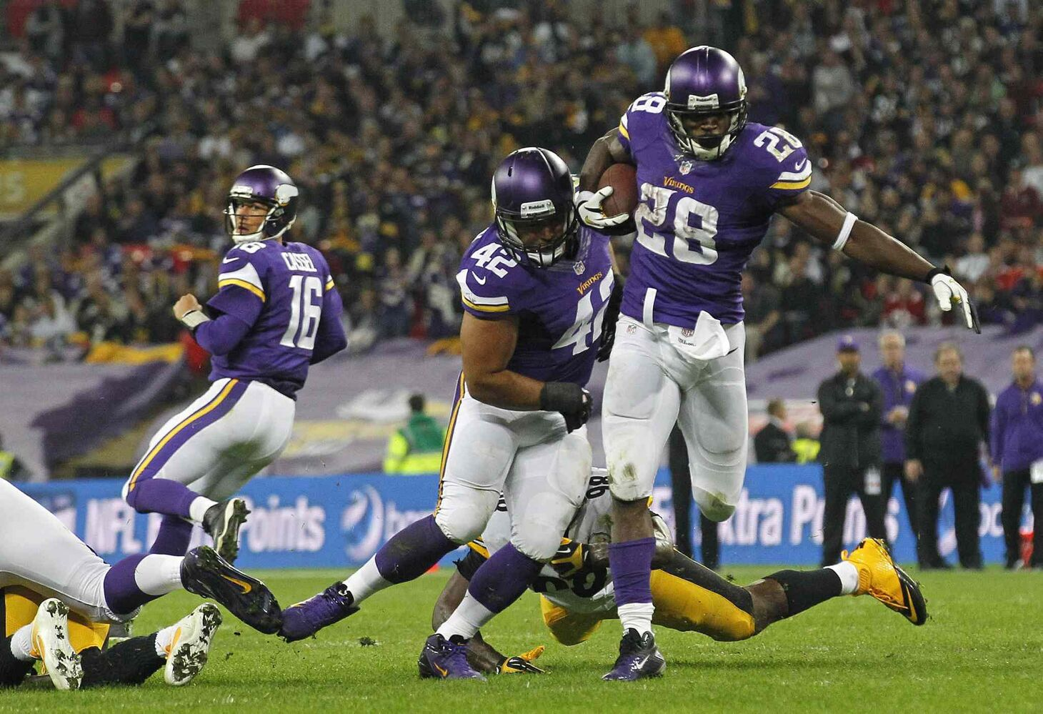 Minnesota Vikings quarterback Matt Cassel (left), watches as running back Adrian Peterson (right) rushes down field during the Vikes' 34-27 win over the Pittsburgh Steelers at Wembley Stadium in London on Sunday.
