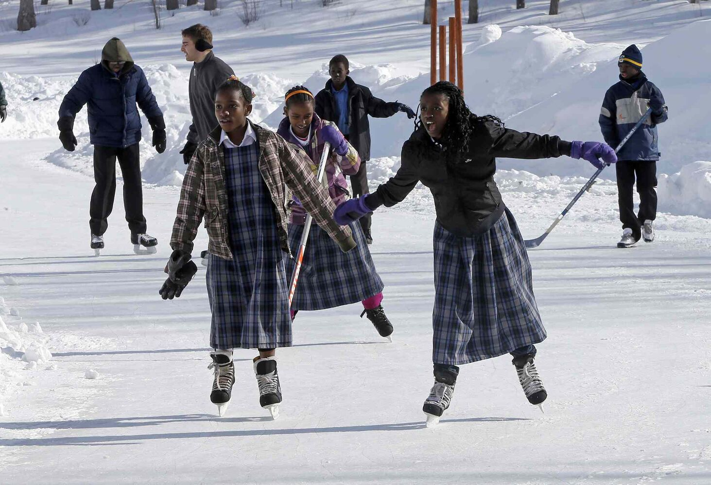 An all-too-brief break in bitter cold brought hundreds to the Forks to skate and walk the River Trail on the Louis Riel Day long weekend. From left, Debra Eddi, 10, Marina  Wedaju, 12, and Salamawit Gebarasaage, 13.