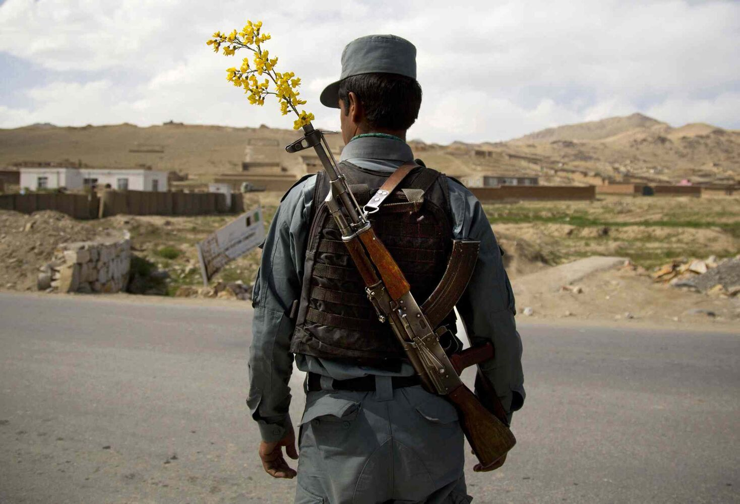 May 15, 2013: An Afghan National Police officer mans a checkpoint in the outskirts of Maidan Shahr, Wardak province, Afghanistan.  (Anja Niedringhaus / The Associated Press)