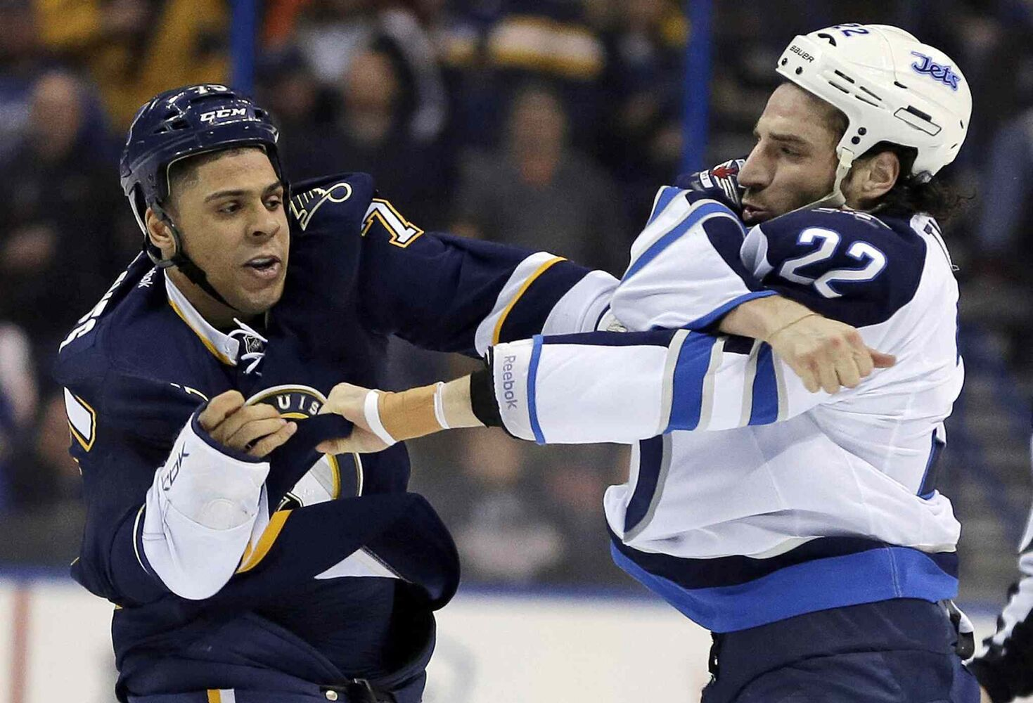 St. Louis Blues' Ryan Reaves, left, and Winnipeg Jets' Chris Thorburn have a first-period fight. (Jeff Roberson / The Associated Press)