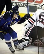 St. Louis Blues' Maxim Lapierre (40) celebrates a game-winning goal by teammate Barret Jackman as Chicago Blackhawks' goalie Corey Crawford, right, looks away during overtime in Game 2 of a first-round NHL hockey playoff series, Saturday, April 19, 2014, in St. Louis. (AP Photo/Bill Boyce)