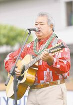 Grammy Award-winning Hawaiian musician George Kahumoku Jr. performs before the first round of the Hyundai Tournament of Champions at the Plantation Course.