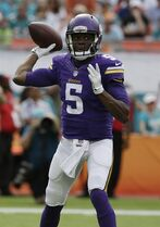 Minnesota Vikings quarterback Teddy Bridgewater (5) looks to pass during the first half of an NFL football game against the Miami Dolphins, Sunday, Dec. 21, 2014, in Miami Gardens, Fla. (AP Photo/Lynne Sladky)