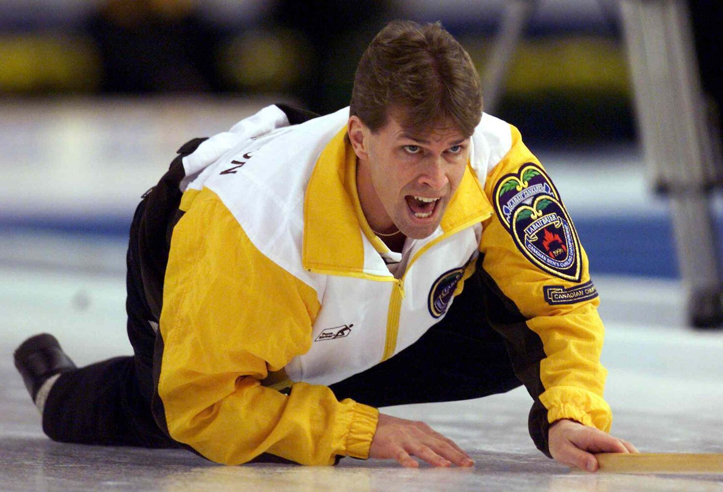 Stoughton yells for his team to sweep during the Brier final against Quebec in 1999. (Chuck Stoody / The Canadian Press Files)