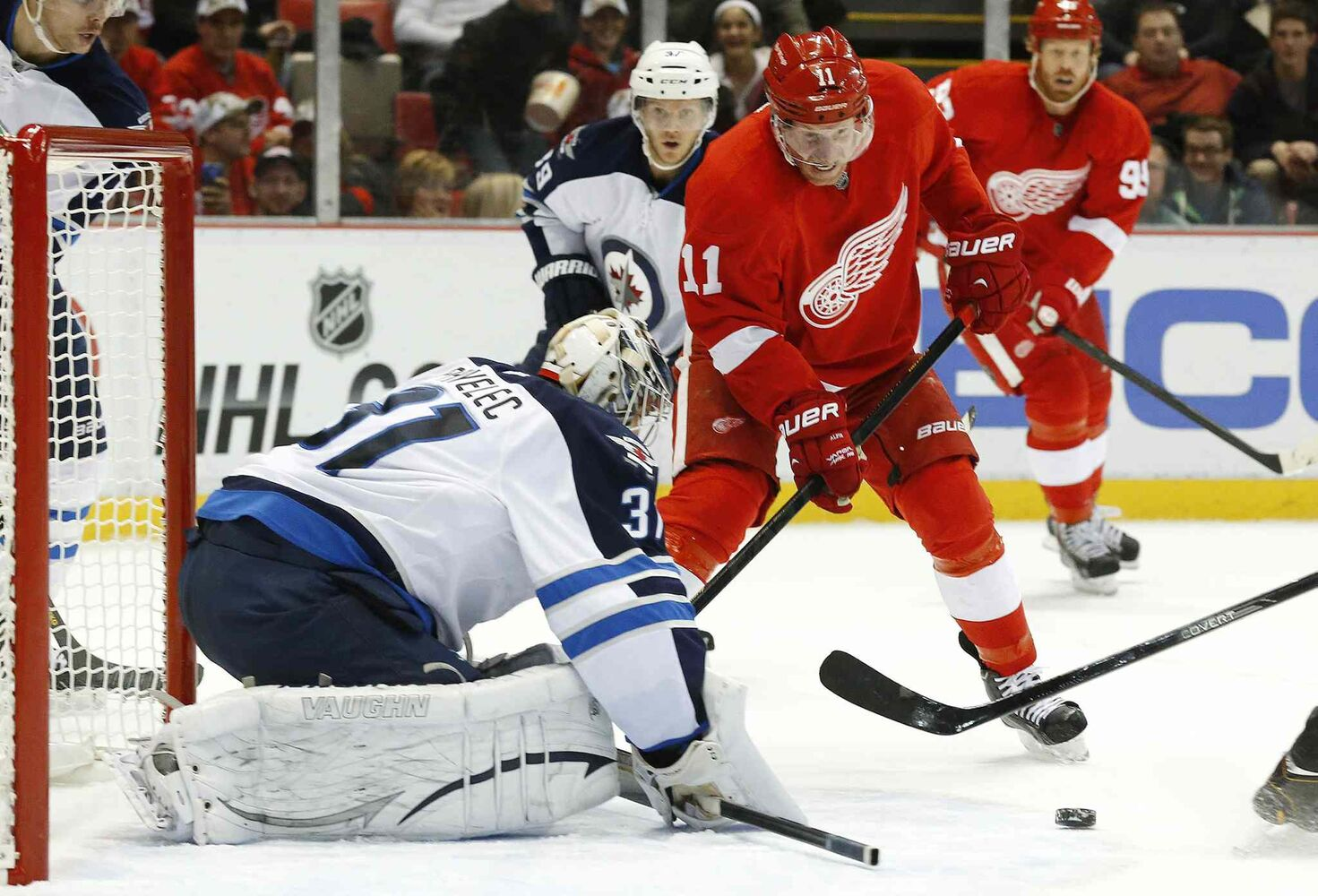 Winnipeg Jets goalie Ondrej Pavelec stops a shot from Detroit Red Wings forward Daniel Alfredsson during the second period.
