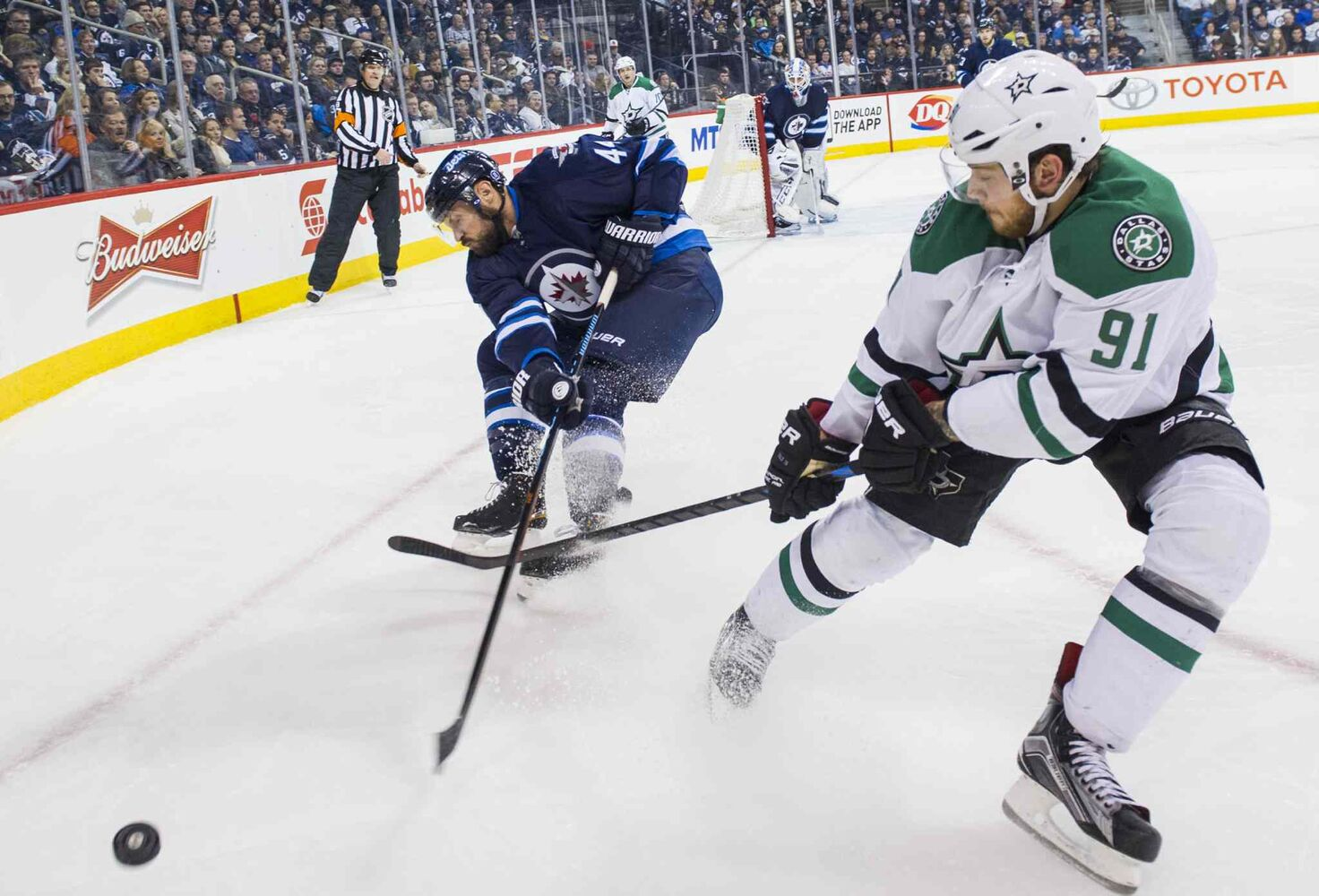 Winnipeg Jets Zach Bogosian (#44) fights for the puck against Dallas Stars Tyler Sequin during the third period of Saturday's game. The Stars won 5-2. (DAVID LIPNOWSKI / WINNIPEG FREE PRESS)