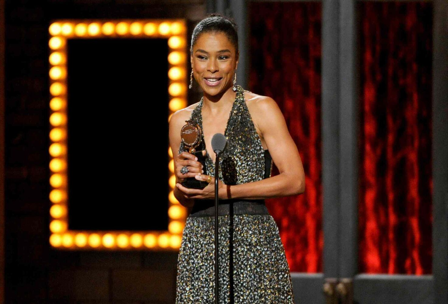 "Sophie Okonedo accepts the award for best performance by an actress in a featured role in a play for ""A Raisin in the Sun"".   (Evan Agostini / The Associated Press)"