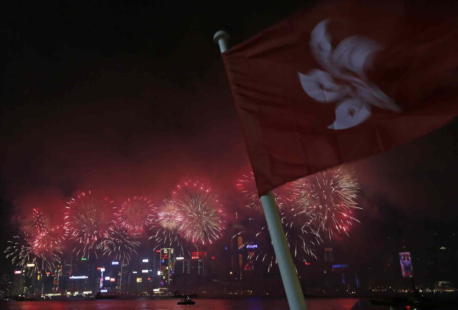 Fireworks explode over the Victoria Harbour to celebrate the Chinese Lunar New Year in Hong Kong on Saturday, Feb. 1, 2014.  (Vincent Yu / The Associated Press)