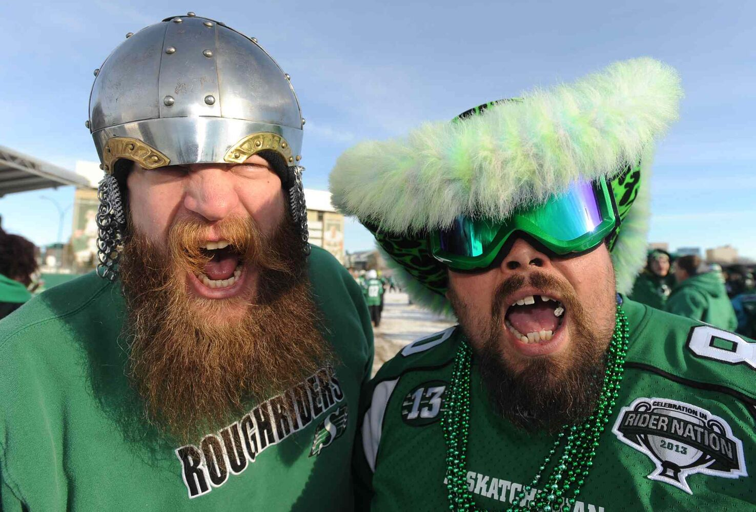 Saskatchewan Roughriders fans Ben Bandenberg (left) and Dave Friesen ham it up outside Mosaic Stadium before the Grey Cup game.