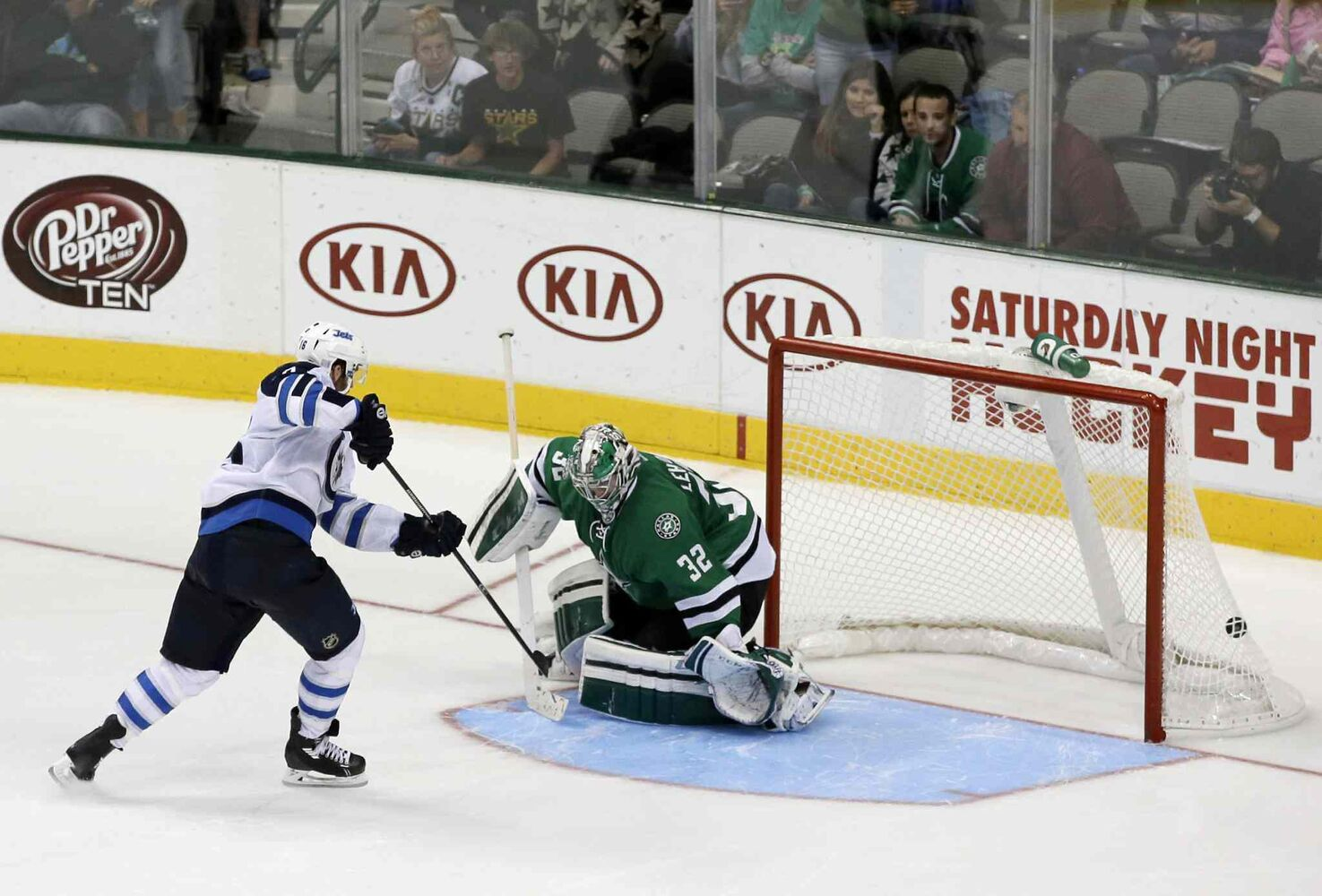 Andrew Ladd scores what would end up being the shootout-winning goal against Kari Lehtonen.