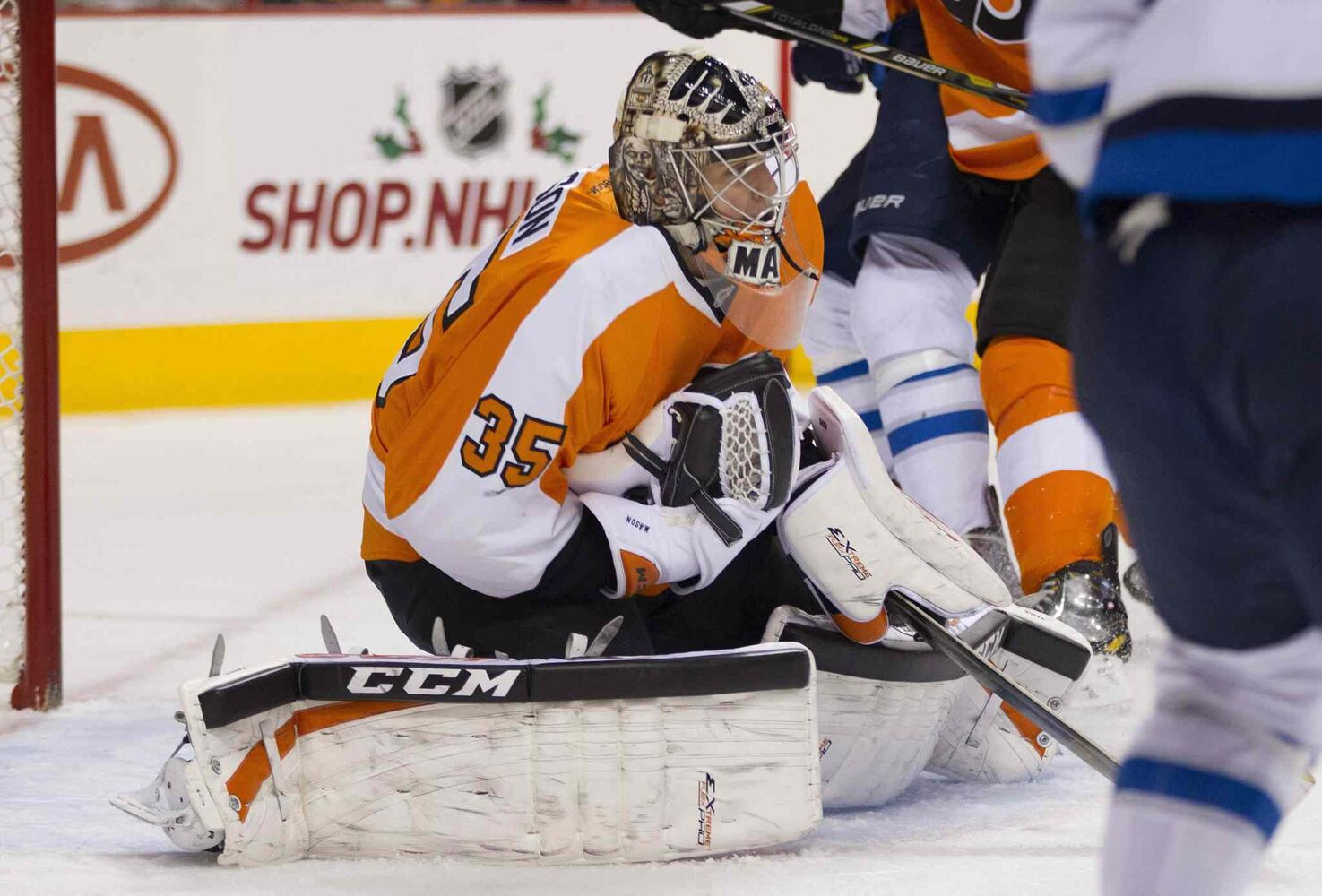 Steve Mason makes a save during the first period.