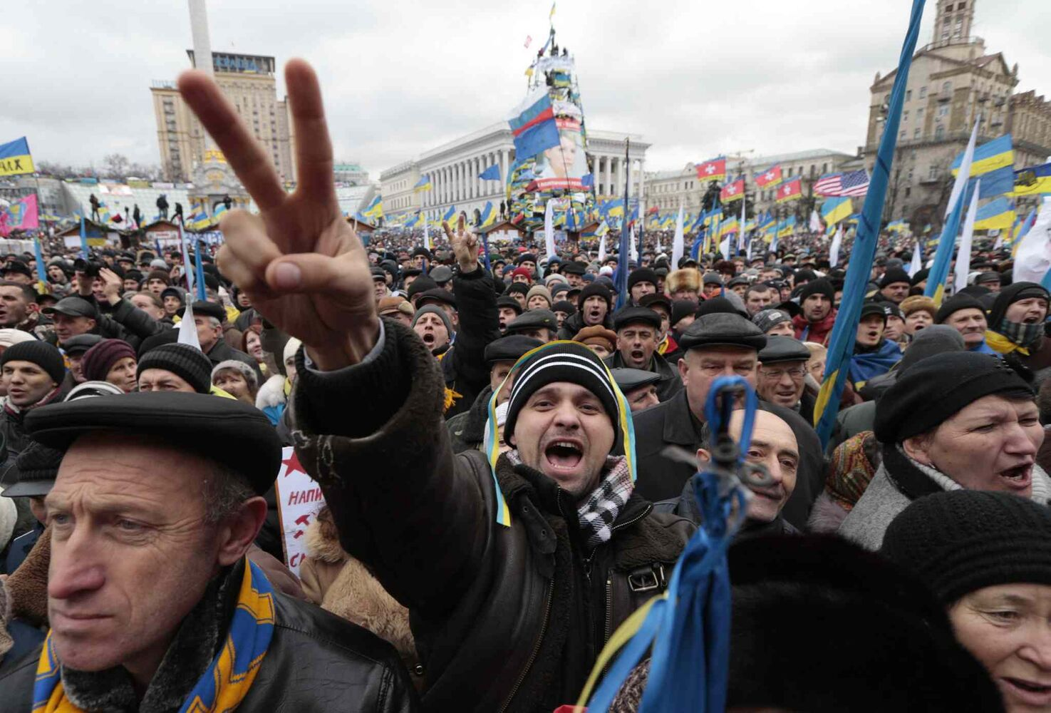 Pro-European Union activists shout slogans during a rally in the Independence Square in Kyiv Sunday.   (The Associated Press)