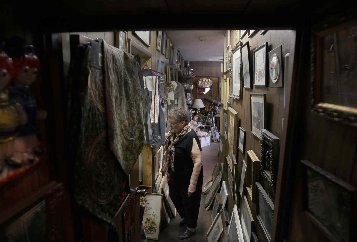 Vivian Proden makes her way through the tiny hallways in her store. Proden, 84, owns Junk for Joy just East of  Portage La Prairie, Manitoba on Hyw. She is retiring after 34 years in the junk business and is having a 50% off sale starting this Friday. ((JOE BRYKSA / WINNIPEG FREE PRESS))