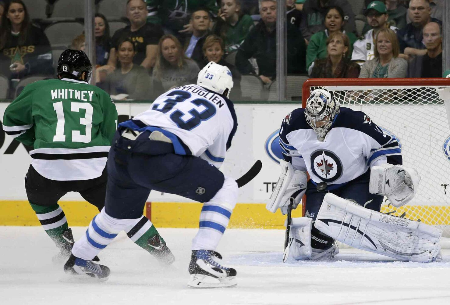 Winnipeg Jets goalie Ondrej Pavelec (right) blocks a shot from Dallas Stars winger Ray Whitney as Jets defenceman Dustin Byfuglien backchecks during the first period Saturday night's game in Dallas. (Tony Gutierrez / The Associated Press)