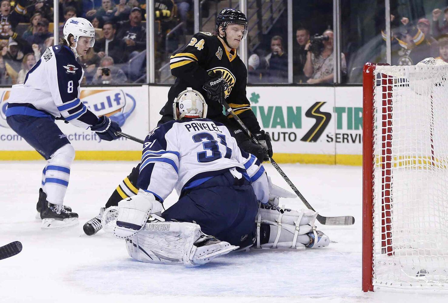 Boston Bruins' Carl Soderberg (34) scores past Winnipeg Jets' Ondrej Pavelec (31) during the game's second period in Boston Saturday. (Michael Dwyer / The Associated Press)