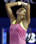 Madison Keys of the U.S. celebrates after defeating Petra Kvitova of the Czech Republic in their third round match at the Australian Open tennis championship in Melbourne, Australia, Saturday, Jan. 24, 2015. (AP Photo/Lee Jin-man)