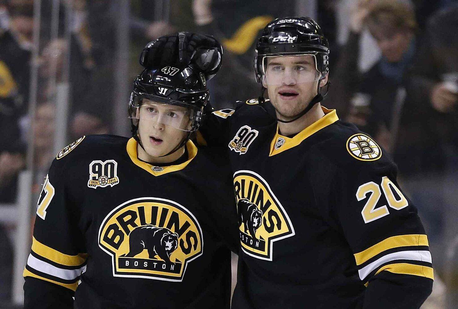 Boston Bruins' Torey Krug, left, celebrates his goal with teammate Daniel Paille (20) during the second period against the Winnipeg Jets Saturday. (Michael Dwyer / The Associated Press)