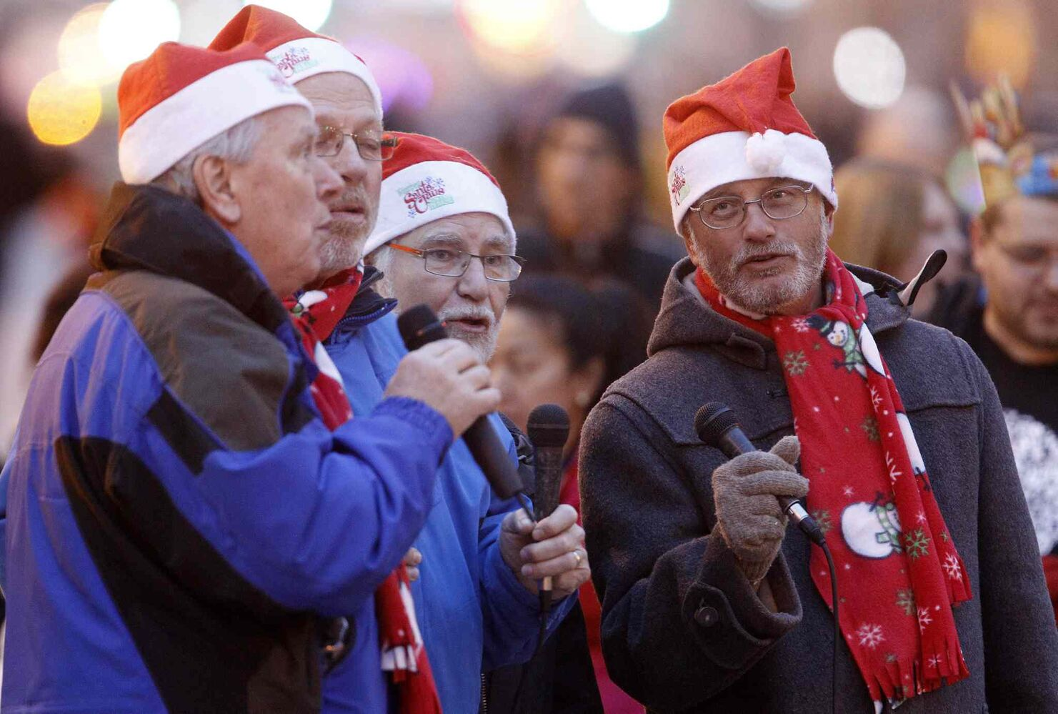 Men sing Christmas carols at the Santa Claus Parade. (TREVOR HAGAN / WINNIPEG FREE PRESS)