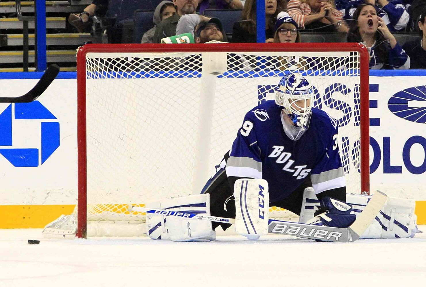 Tampa Bay Lightning goalie Anders Lindback stays down as the puck bounces out of the net after getting beaten by Mark Scheifele in overtime.