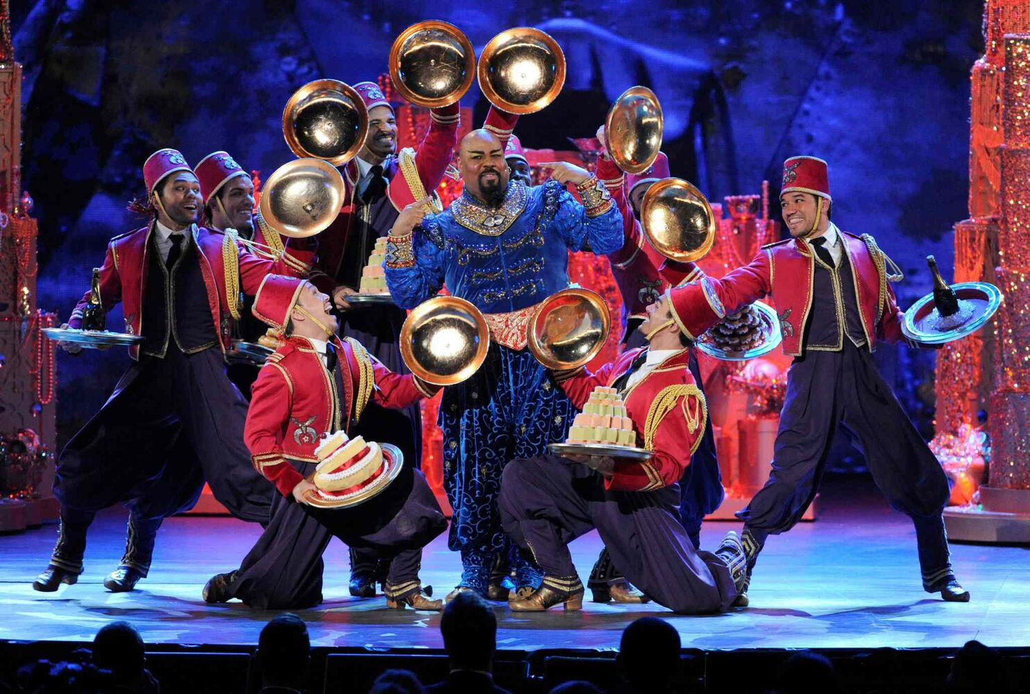 "James Monroe Iglehart, centre, and the cast of ""Aladdin"" perform.  Inglehart went home with a Tony in the best performance by an actor in a feature role in a musical category.   (Evan Agostini / The Associated Press)"