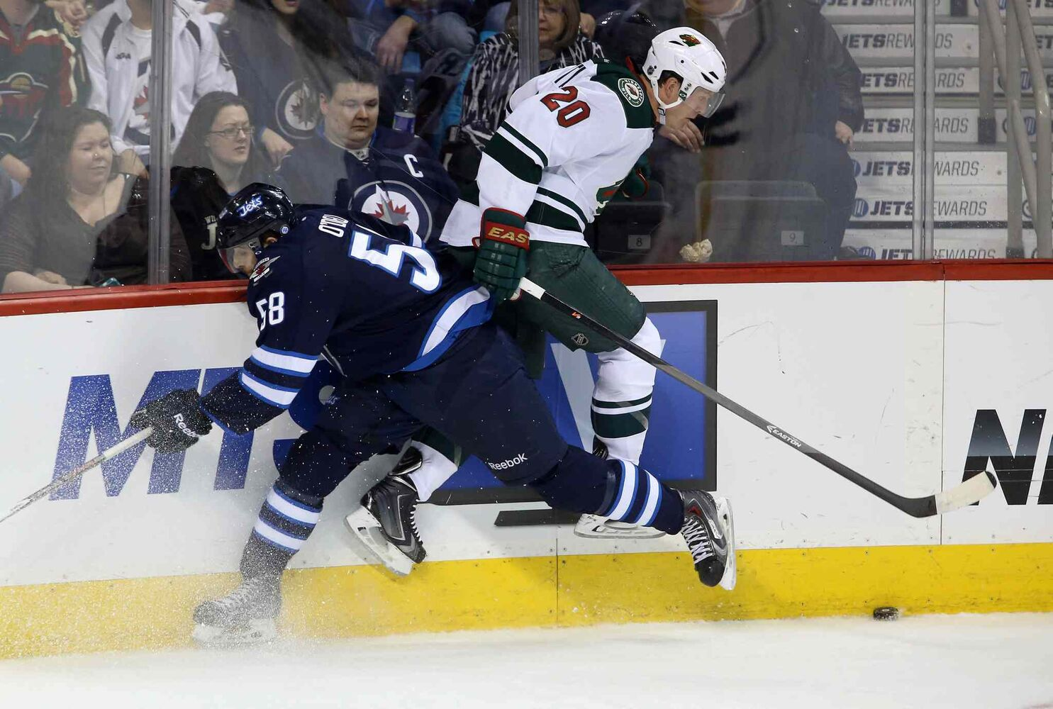 The Jets' Eric O'Dell collides with the Wild's Ryan Suter in the third period. (TREVOR HAGAN / THE CANADIAN PRESS)
