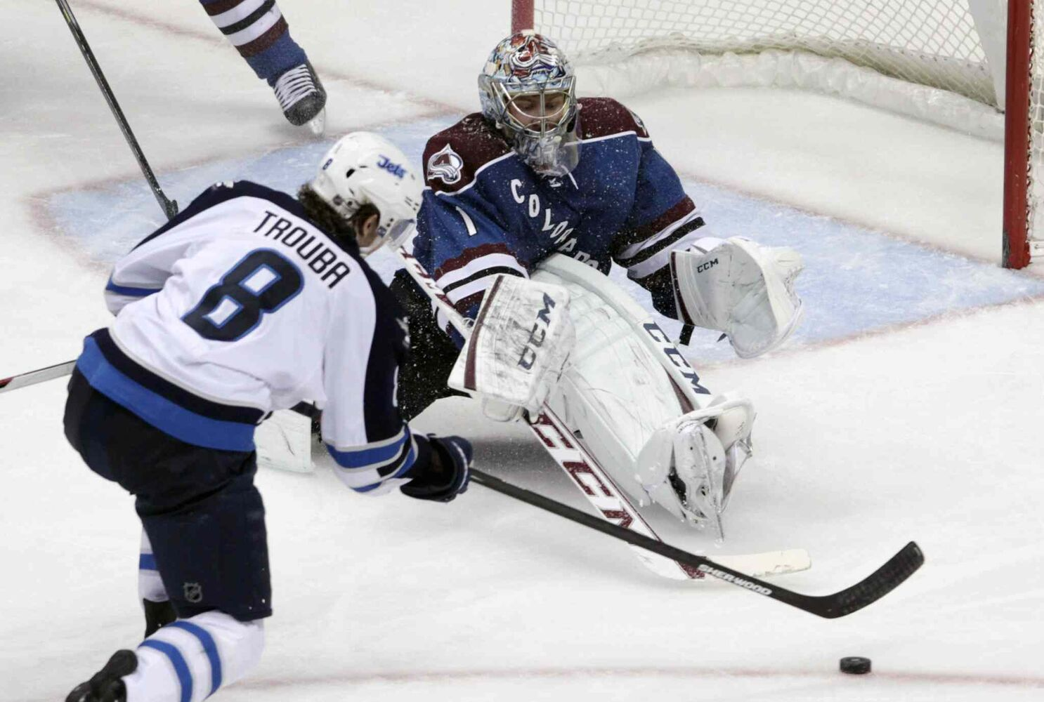 Colorado Avalanche goalie Semyon Varlamov (right) sets up against Winnipeg Jets defenceman Jacob Trouba during the third period.