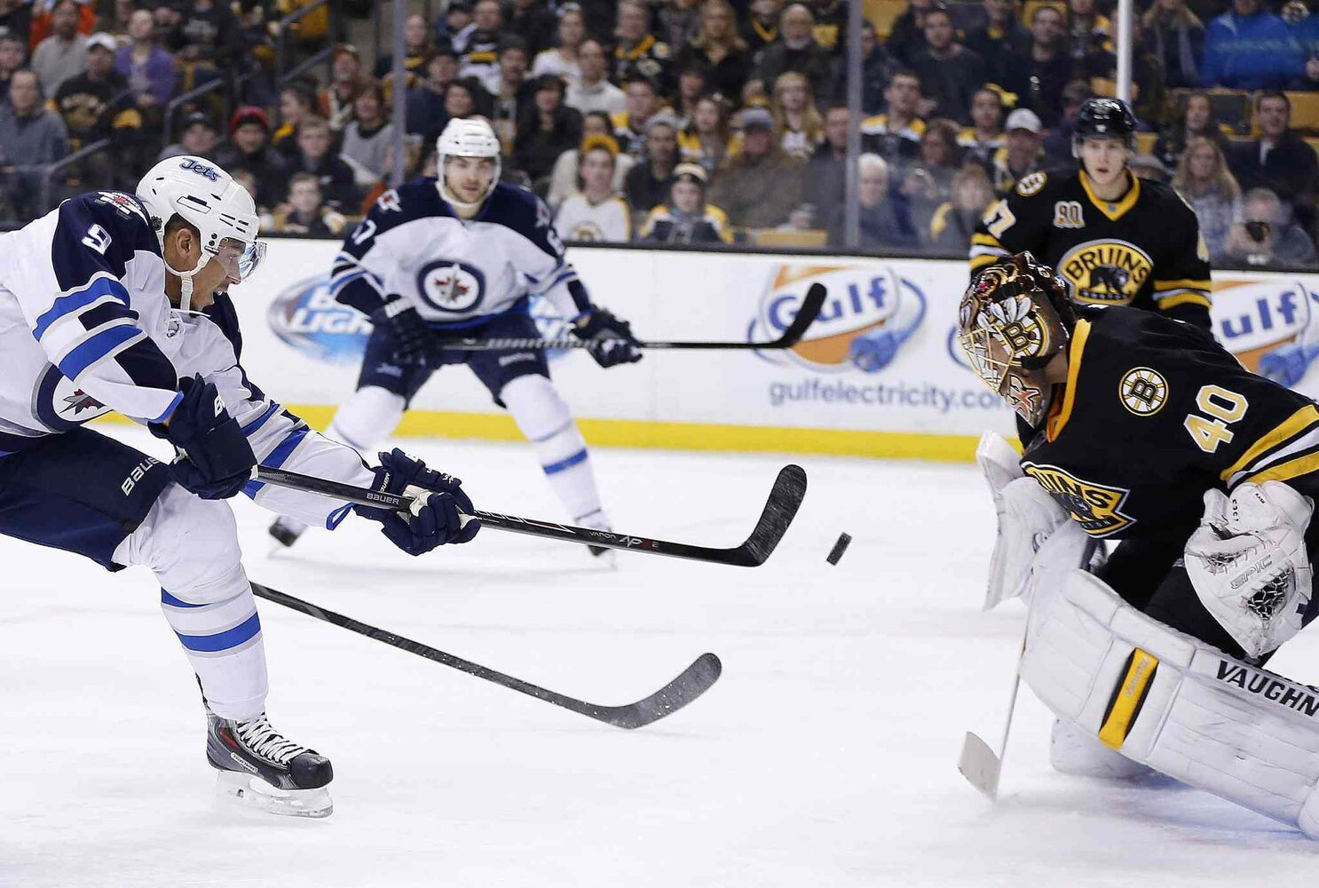 Winnipeg Jets' Evander Kane (9) takes a shot on Boston Bruins' Tuukka Rask (40) in the first period Saturday.