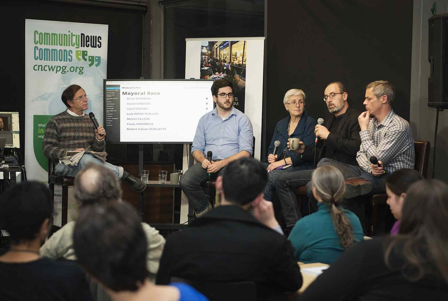 From left, Donald Benham, Zach Fleisher, Shannon Sampert, Jino Disastio, and James Turner participate in the community news commons civic elections panel at the News Café.  (Sarah Taylor / Winnipeg Free Press)