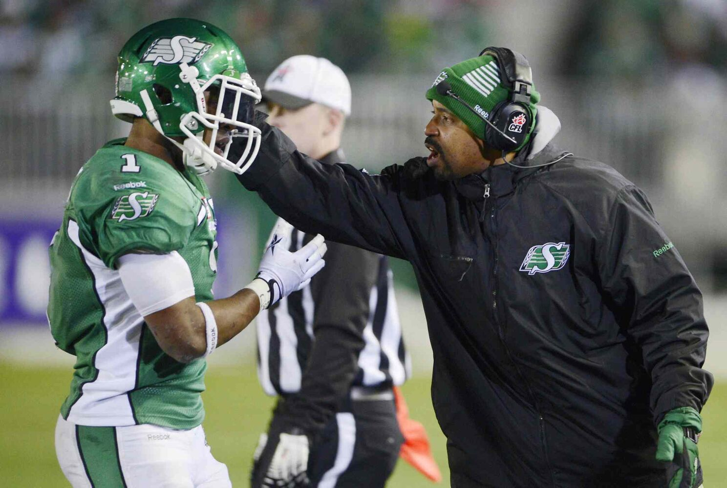 Saskatchewan Roughriders quarterbacks coach Khari Jones (right) talks to Roughriders running back Kory Sheets during the fourth quarter.