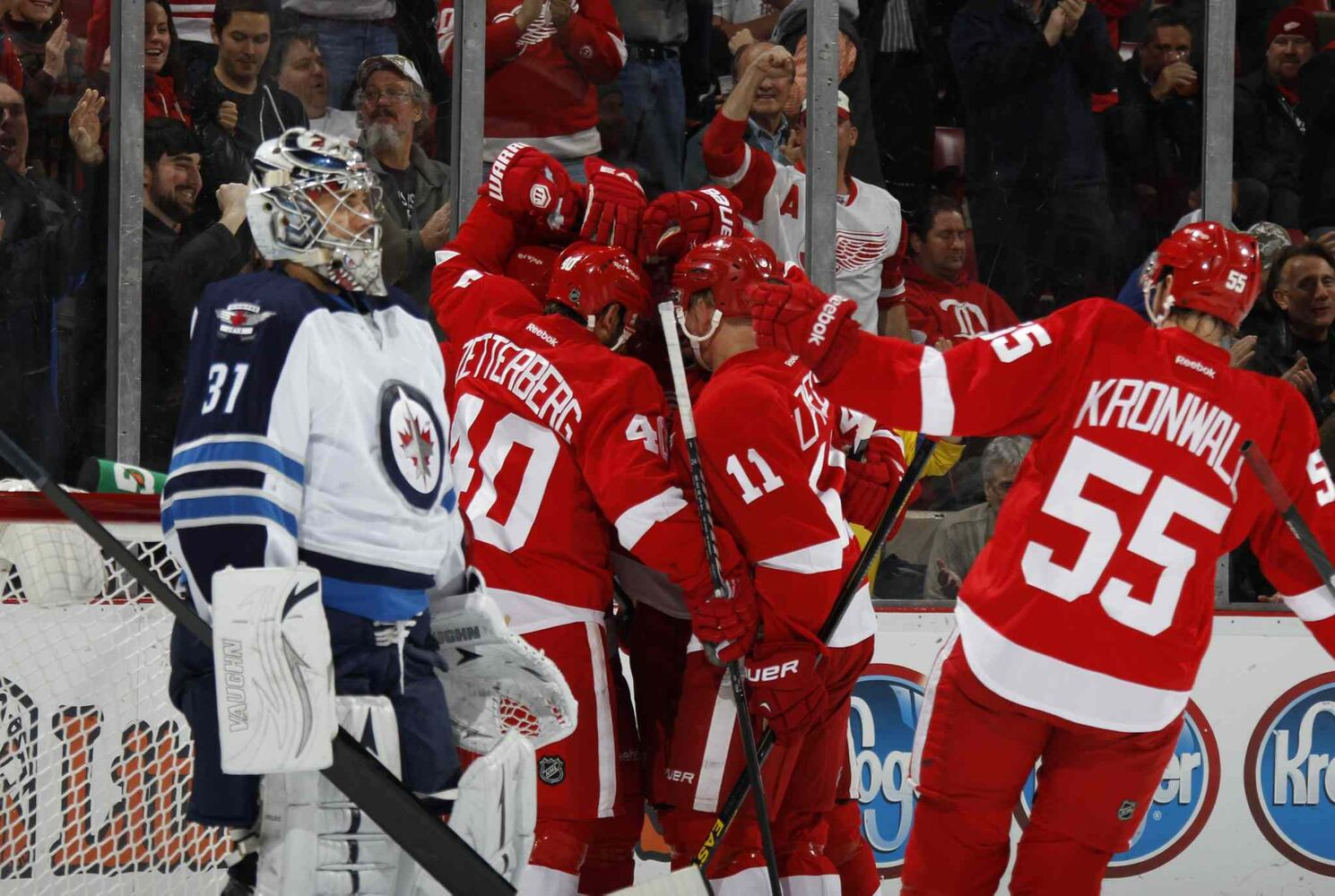 Detroit Red Wings players congratulate Pavel Datsyuk after his first-period goal against Winnipeg Jets goalie Ondrej Pavelec. (Julian H. Gonzalez / Tribune Media MCT)