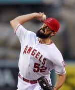 Los Angeles Angels starting pitcher Matt Shoemaker throws to the plate during the first inning of a baseball game against the Seattle Mariners, Monday, May 4, 2015, in Anaheim, Calif. (AP Photo/Mark J. Terrill)