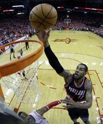 Portland Trail Blazers' LaMarcus Aldridge (12) goes up for a shot against the Houston Rockets during the second half in Game 1 of an opening-round NBA basketball playoff series Sunday, April 20, 2014, in Houston. The Trail Blazers won 122-120 in overtime. (AP Photo/David J. Phillip)