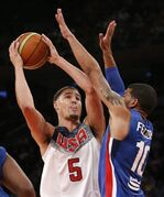 Dominican Republic guard James Feldeine defends U.S. guard Klay Thompson (5) in the first half of an exhibition basketball game at Madison Square Garden in New York, Wednesday, Aug. 20, 2014. (AP Photo/Kathy Willens)