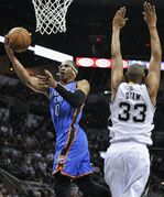 Oklahoma City Thunder guard Russell Westbrook (0) shoots against San Antonio Spurs forward Boris Diaw, of France, during the first half of an NBA basketball game, Wednesday, March 25, 2015, in San Antonio. (AP Photo/Darren Abate)