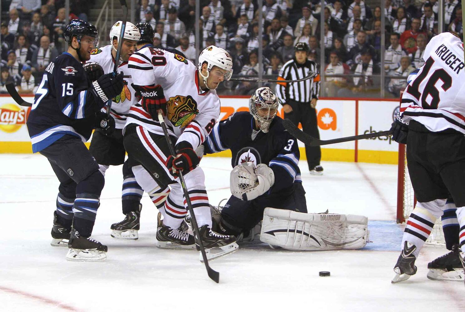 Brandon Saad of the Blackhawks tries to get the puck past Jets goalie Ondrej Pavelec during the first period. (Chicago Blackhawks #20 )