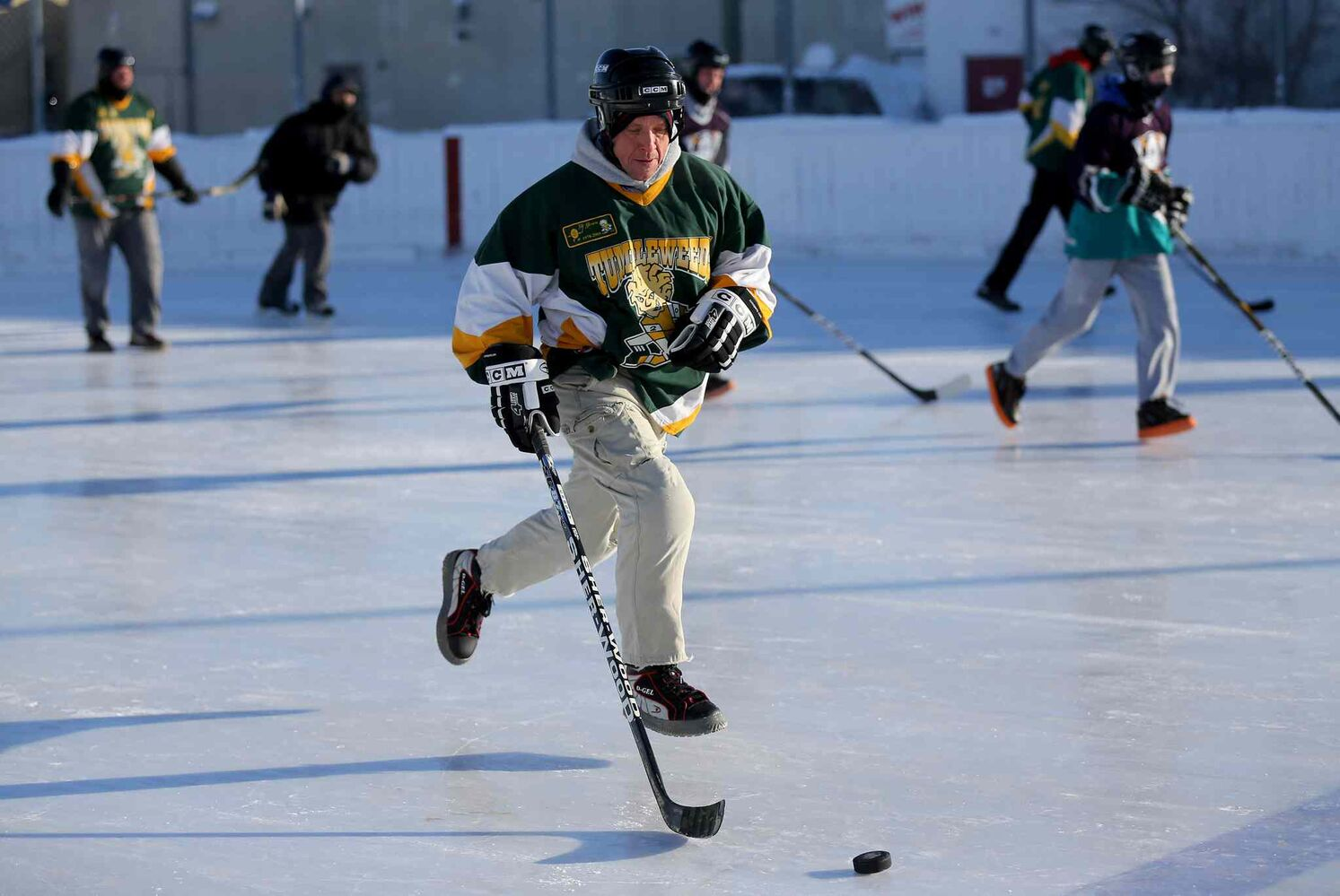 Colin Mackenzie of the Tumbleweeds plays against the Mighty Puckin' Drunks during a spongee game at Melrose Park Community Centre on Jan. 4, 2014. (Trevor Hagan / The Winnipeg Free Press)