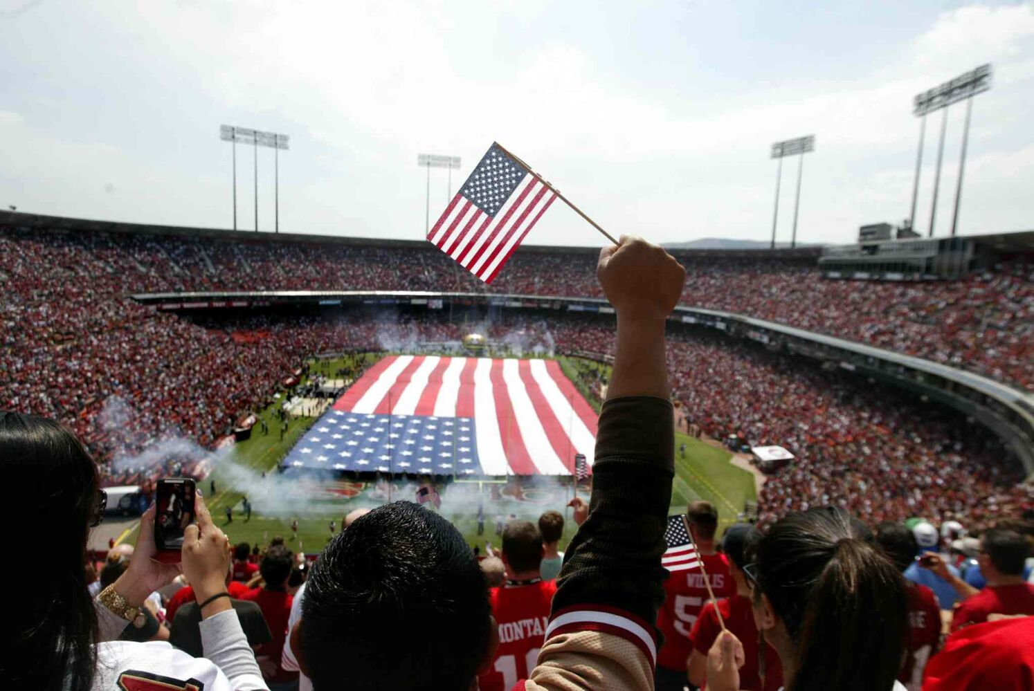 An American flag unfurls on the field during to commemorate the 10th anniversary of the 9/11 terrorist attacks prior to the NFL season home-opener between the San Francisco 49ers and the Seattle Seahawks on Sunday, September 11, 2011.