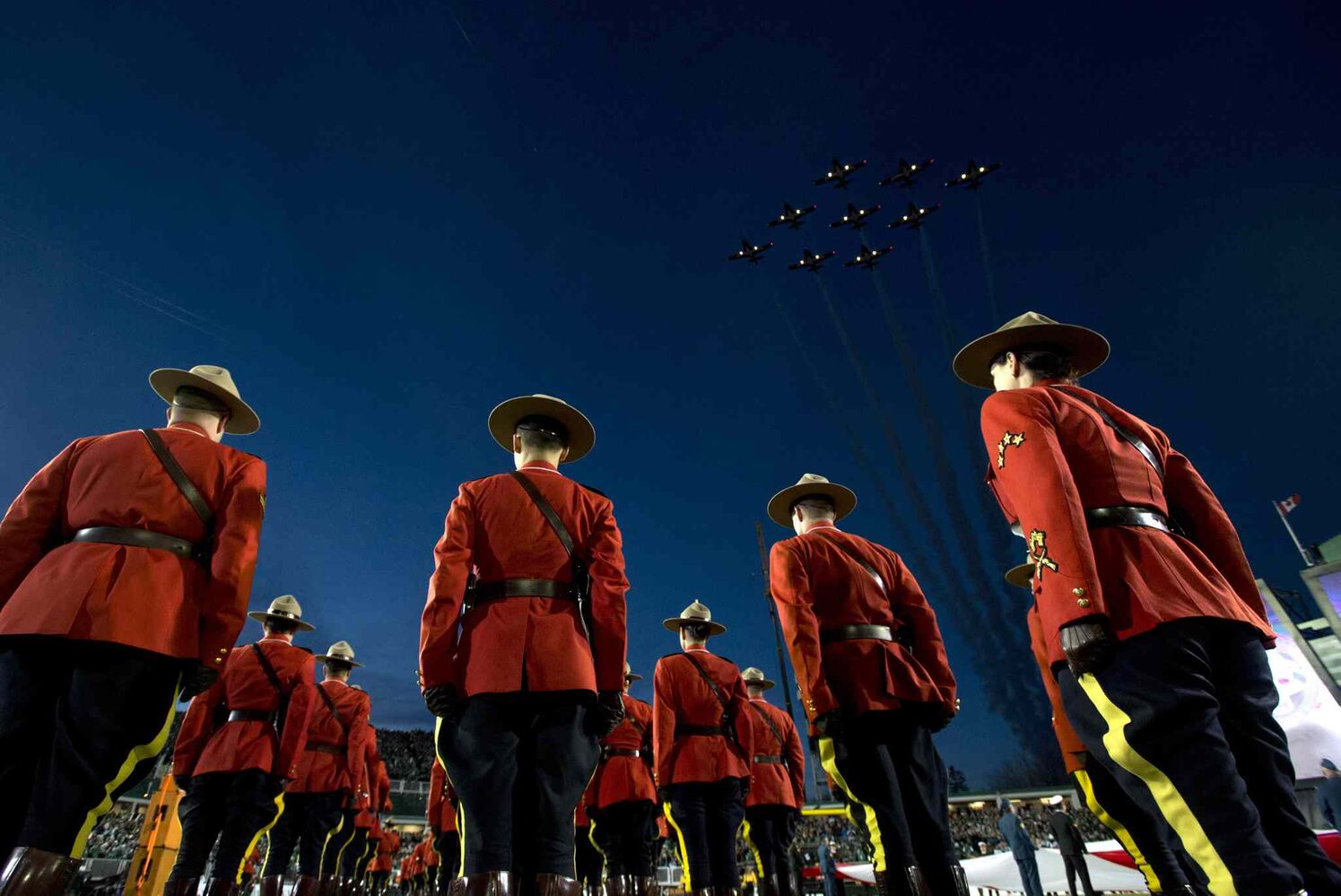 The Snowbirds fly over the field during pre-game ceremonies at the Grey Cup. (Frank Gunn / The Canadian Press)