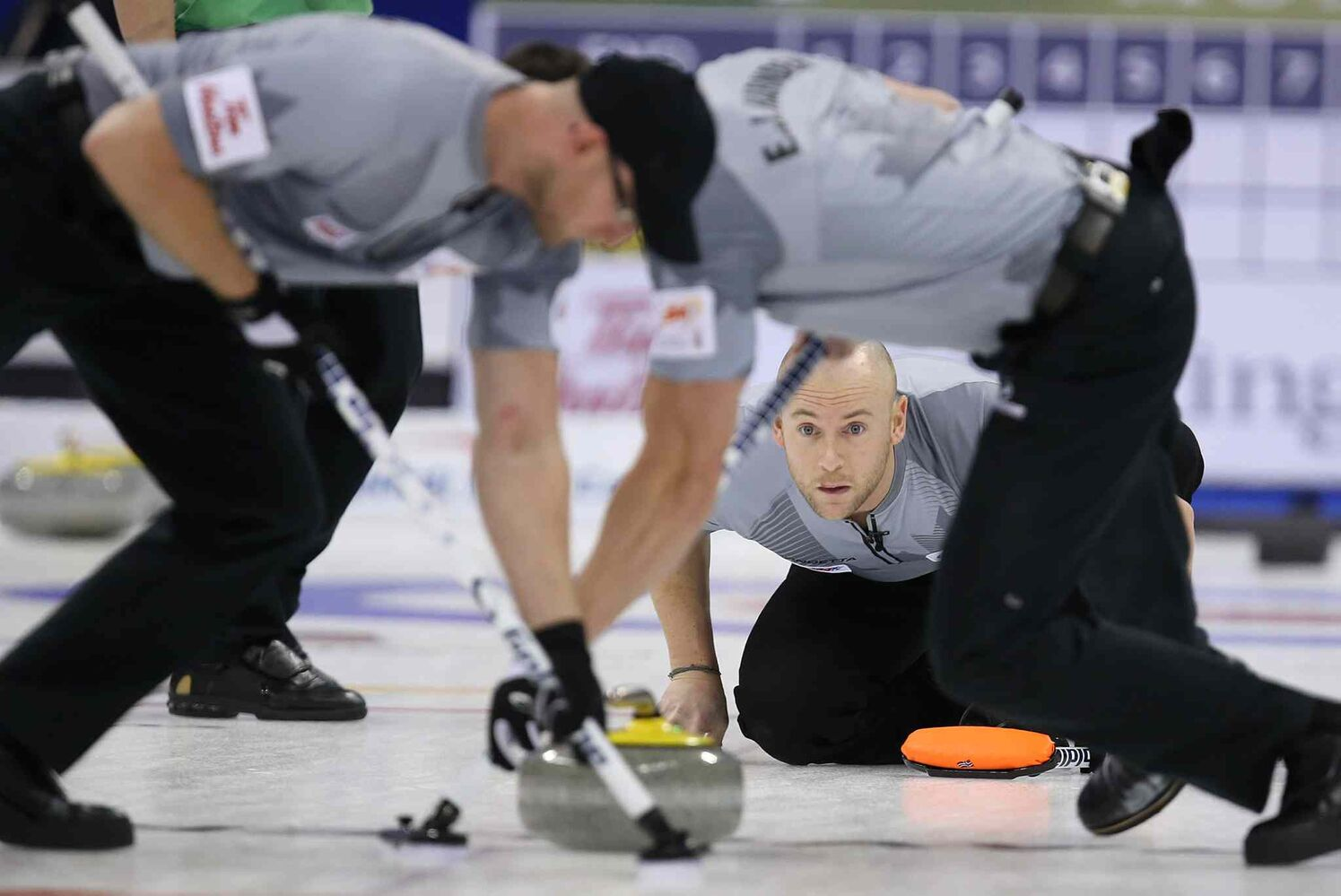 Third Ryan Fry of Brad Jacobs' team watches his shot as the sweepers jump on the rock. (Jason Halstead / Winnipeg Free Press)