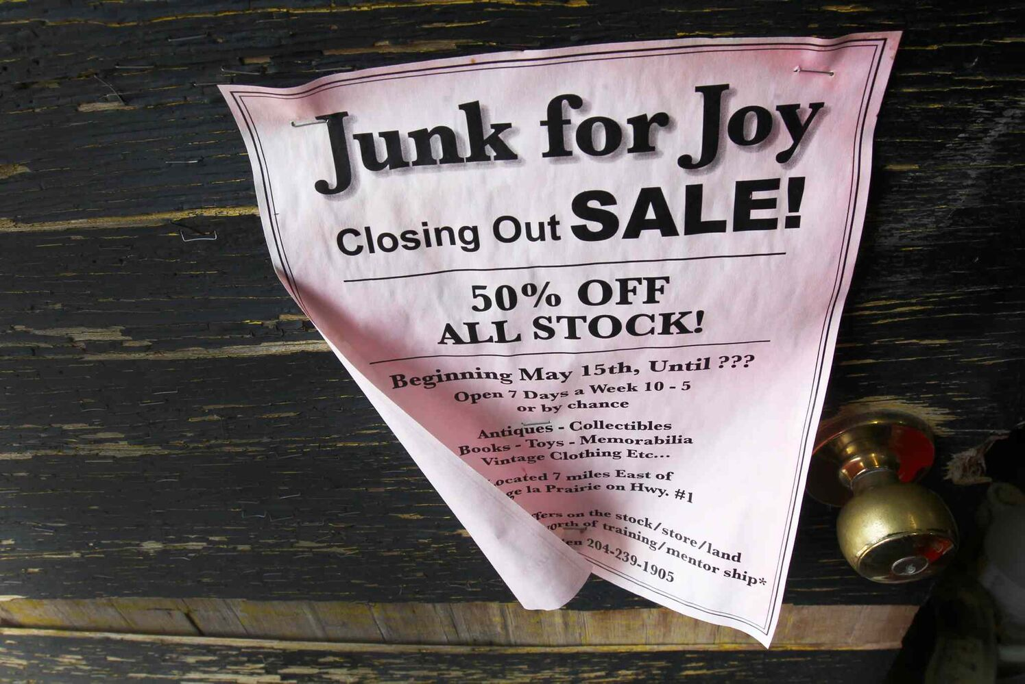 Last sale flyer boasted on front door of store. Vivian Proden owns Junk for Joy just East of  Portage La Prairie, Manitoba on Hyw. #1 - Vivian, 84, is retiring after 34 years in the junk business and is having a 50% off sale starting this Friday.  ((JOE BRYKSA / WINNIPEG FREE PRESS))