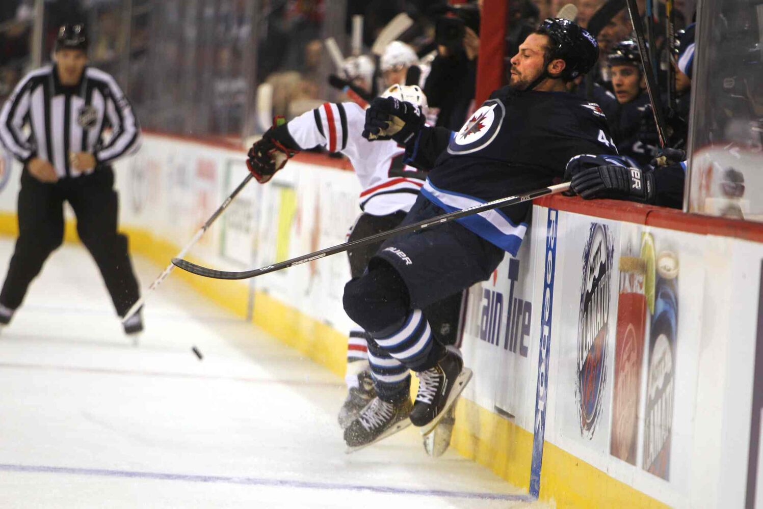 Zach Bogosian gets shoved into the boards. (Ruth Bonneville / Winnipeg Free Press)