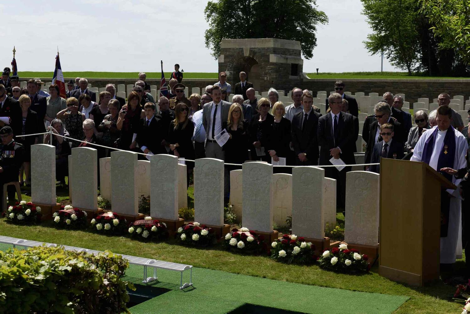 Flowers are laid at the headstones of eight Canadian First World War soldiers from the 78th Battalion at the Caix British Cemetery in Caix, France on 13 May 2015 as part of the largest single find of unknown Canadian soldiers since the Canadian Armed Forces Casualty Identification program started in 2006.