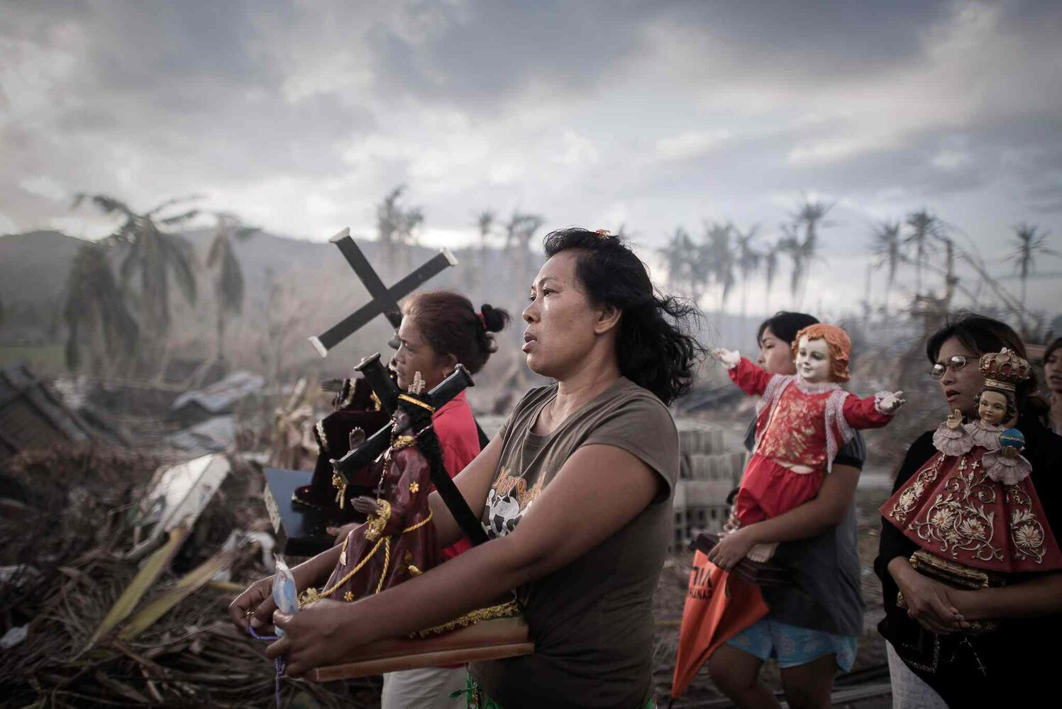 First prize in the Spot News Single category by Phillipe Lopez of France<p>  Survivors of typhoon Haiyan march during a religious procession in Tolosa, on the eastern island of Leyte, Philippines, Nov. 18, 2013. One of the strongest cyclones ever recorded, Haiyan left 8,000 people dead and missing and more than four million homeless after it hit the central Philippines.